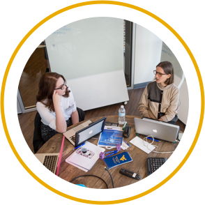 Two girls having a discussion in a conference room